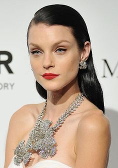 Old-School Beauty: Take note of Jessica Stam's vintage glamour for your New Year's Eve celebration. Don soft cat-eye liner, side-swept strands, and a severe red lipstick with retro jewels for the fanciest of holiday parties. Jessica Stam, New Year's Eve Celebrations, Cat Eyeliner, Vogue, Hair Creations, Holiday Hairstyles, Christmas Makeup, Purple Hues, Vintage Glamour