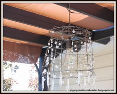 DIY rustic chandelier made from a tomato cage..cheap way to do what I want. More stuff on it though
