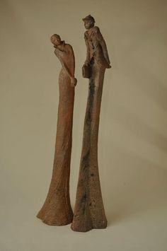 Sculpture longue femme et homme terre cuite modelage