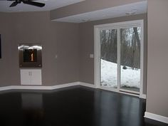 I love this paint color with the dark floor and white trim! (Waynesboro taupe - benjamin moore) I love this too! Living Room Colors, Living Room Paint, Living Room Decor, Light Grey Walls, Wall Paint Colors, House Inside, Creative Decor, Home Improvement Projects, House Painting