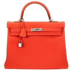 Preowned 2015 Hermes Capucine Orange Togo Leather Kelly 35cm (18,850 CAD) ❤ liked on Polyvore featuring bags, handbags, orange, leather handbags, red leather purse, red leather tote bag, leather tote handbags and leather purses