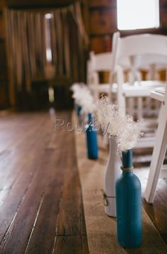 Ailse decor with painted wine bottles, burlap and dried babys breath