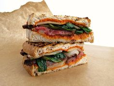 Pressed Skirt Steak Sandwich with Grilled Ramps, Manchego, and Romesco
