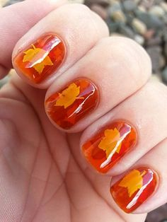 Pond mani, with leaves. PERFECT for fall.  Polish is L'Oréal Mango Mama, stamped with yellow, orange and brown leaves, using Vivid Lacquer stamping plate VL013, shared by Angela: