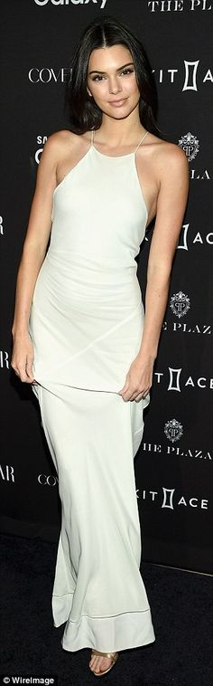 Head turner:Playing with the fabric of her skirt to occasionally expose her champagne-hue...