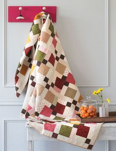 This version of the Disappearing Nine Patch quilt is made using light and dark shirting prints. Both the light and dark parts of this pattern are scrappy for more variety. Tony added sashing and squares to make this quilt large enough for a twin-size or full-size bed.