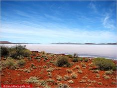 Glistening salt lake surrounded by red hills in the Gawler Ranges, South Australia