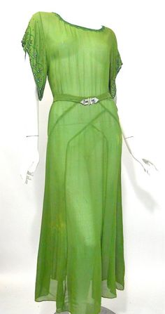 Vintage Fashion Moss green silk chiffon gown with deco seaming and beaded sleeves. Beads at neckline and down slit at center of back to waist, self belt with silvertone metal and rhinestones on clasp. 1930s Fashion, Art Deco Fashion, Retro Fashion, Vintage Fashion, Victorian Fashion, Fashion Fashion, Vintage Outfits, Vintage Gowns, Dress Vintage