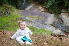 Lifestyle portraits in the Blue Ridge Mountains: Waterfall sitting at 6 months old. Blowing Rock, NC. By Calm Cradle Photo & Design (Chapel Hill, NC)