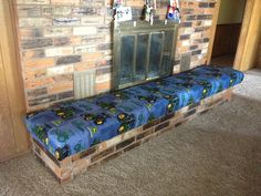 Fireplace hearth childproofed with a home made bench.