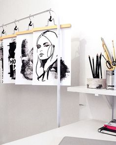 Clothing hangers are a clever way to display your fashion illustrations. The rose golden ones are by Danish design label Hay. They look good with a print clipped to them, but also lend themselves to other purposes. Why not use them to display a favourite item of clothing, sparkly jewellery or a row of pretty scarves?