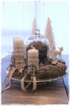 Advent wreath, rustic charm, music sheet candles, wooden stars, moss and snow. www.skreytumhus.is