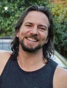 Eddie Vedder and his perfect teeth, smile, dimples, eyes and that exceptional ability to write lyrics that speak from my core