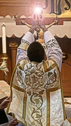 """""""God is as really present in the consecrated Host..."""