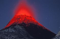 """Erupting cone at Lengai volcano (Tanzania)    A """"historic"""" photo - an eruption from one of the hornitos  (small spatter cones), now buried by the new ash cone growing since  Sep 2007 in the active crater of Ol Doinyo Lengai volcano (northern  Tanzania)"""