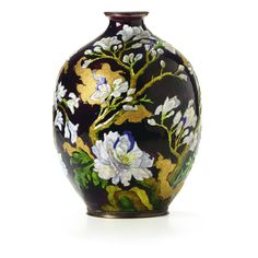 A Camille Fauré enamelled metal vase enamelled with flowering branches in shades of white, pink, green, blue, gold and silver on a reddish-brown ground signed Camille Fauré Limoges France in gold enamel height 29 cm