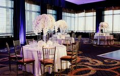 The white elegant centerpiece at the wedding by Tantawan Bloom