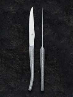 Designer Philippe Starck created these table knives in stainless steel with a satin finish. He is one of many designers and creators who designed new, innovate and beautiful interpretations of the traditional Forge de Laguiole® knife. #forgedelaguiole #laguiole #laguioleknife #knives #madeinfrance #philippestarck #designer