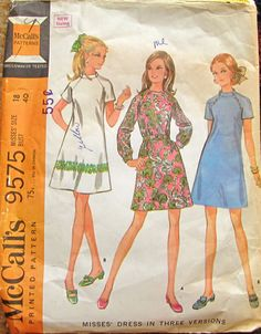 McCall's 9575; 1968; Misses Dress in Three Versions -- Three section dress, with long or short raglan sleeves, has center back zipper. Dress, lightly fitted by French darts in front and vertical darts in back, has faced neck and shoulder darts. Long sleeves are gathered into buttoned bands and dress is worn with buckled self fabric belt. Short sleeved dress has three-piece, faced band collar included in neck facing seam