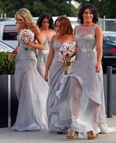 Rebecca Twigley's bridesmaids in beautiful custom pewter J'Aton couture dresses