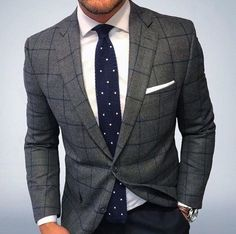with a dapper combo with a white spread collar shirt navy white polka dot tie gray navy window pane blazer with a white cotton pocket square with a watch Mens Fashion Suits, Mens Suits, Men's Fashion, Fashion Outfits, Men's Business Outfits, Business Fashion, Blazer Outfits Men, Herren Outfit, Classy Men