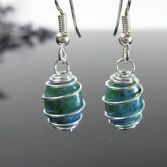 Ready to ship - Aqua stone wire wrapped nickel free earrings. No itchy ears!  Pretty bluish/green dyed stones within a spiral twist. Really cool look!  Adds a pop of color to any outfit!  Photos are taken up close to show as much detail as possible. Please see pics for size comparisons.  Click here for more nickel free jewelry: https://www.etsy.com/shop/AndesBeads?ref=l2-shopheader-name  179