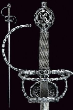 """A pierced rapier. Dating: circa 1600. Italy. Strong, straight blade of lozenge section, tang with crowned stamp """"S""""; iron hilt richly chiselled and pierced, double valve, border, guard, parry rings and rings all featuring baluster-shaped decorations, the valves, quillon-block and pommel pierced with floral motifs; grip with silver wire binding and moor's heads. Llength 130 cm."""