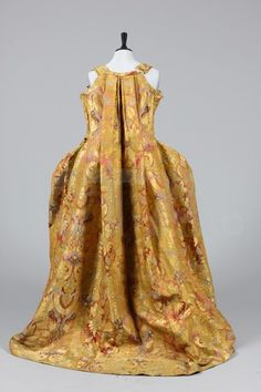 The remains of a luxurious gold brocaded lampas robe à la Française, mid 18th century.