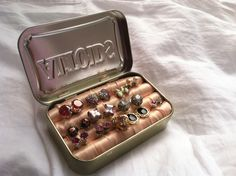 DIY Earring case from an Altoids tin! Rolls of craft foam covered in satin ribbon