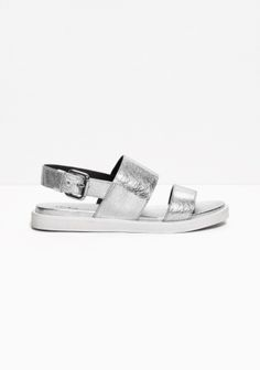 Made from metallic leather, these chunky leather sandals have wide straps with raw edges.
