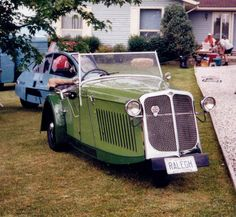 1934 Raleigh Safety Seven... a three-wheeled car built by the bicycle company of the same name, a very rare car, few are known to exist anymore And behind it (blue car) is a 1980's Freeway, an interesting American micro car, for some reason never to
