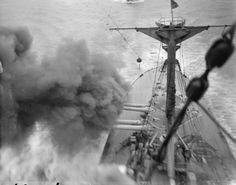 MINISTRY INFORMATION FIRST WORLD WAR OFFICIAL COLLECTION (Q 18138) British Battleship ROYAL SOVEREIGN firing her after turret guns.WW I