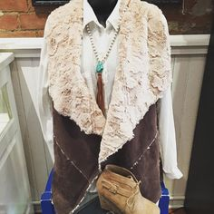 Cozy up in this!!!! Faux suede/fur vest- $39.95 (also in tan) White button down- $34 Tassel necklace- $18.95 Tan Bootie- $32.95  #madisonsbluebrick #vest #suede #fur #cozy #fallfashion #tassel #bootie #shoplocal
