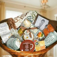 """Zotorius Creations Gift Baskets, LLC This basket consist of the following items: a large wicker laundry basket, two (brown) premium bath towels; Body scrub cleanser belt;  mini size Hawaiian Citrus scented candle; ceramic design tea cup candle burner  with 4 vanilla scented candles; """"Live, Laugh & Love"""" personal coaster, Body works by Raymond Waites Opulent Garden Orange Clove scented 5 Piece Bath and Body Gift Set (Body Butter, Body Scrub, Body Soap, Shower Gel & Bath Puff);  Pillar Candle…"""