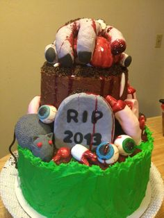 Zombie theme cake, blood, body parts, tomb stone, gory