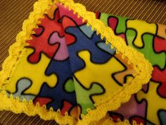 Baby Blanket With Crochet Ruffle - Bright Primary Colors Puzzle Pieces - Baby Girl or Boy - Autism Awareness. $32.00, via Etsy.