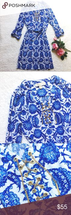 """Michael Kors floral dress Stunning blue&white floral pattern dress by MICHAEL Michael Kors. Size Small. Super soft&stretchy fabric, flattering fit! Gold lace up chain detail on the front chest. Matching belt. Sleeves can be worn 3/4 or long. Measures: flat bust 19""""// shoulder to bottom 36"""". Gently worn and in great condition. Please ask questions 💫 MICHAEL Michael Kors Dresses"""