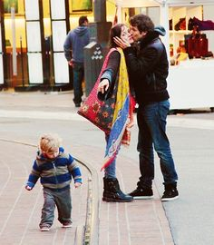 Marion Cotillard, Guillaume Canet with their son  (embroidered bag and scarf)