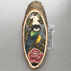Wood slice with an original drawing of a bird door Inkspirednl