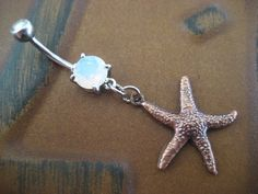 Star Fish Belly Button Jewelry Ring- Double Sided Starfish Charm Dangle Navel Piercing Opal Bar Barbell. $12.00, via Etsy.