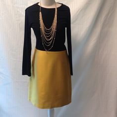 Skirt Satin type material ,rich gold color ,lined w. 31. H. 36 length 21 in. With invisible  zipper in back.  black top not included . J. Crew Skirts
