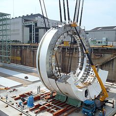 To carve a 57.4-foot-diameter viaduct tunnel UNDER Seattle, engineers have ordered an $80 million tunnel-boring machine (TBM) from Japan with more than 700 cutting tools on its face.