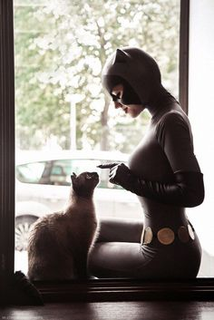 Now behave and I'll be back soon  as CatWoman as deeds ..
