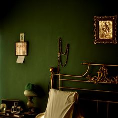 This is a great period feel - romantic green and gold. M&L Olive Green.   https://www.marston-and-langinger.com/Shop/Paint/Olive-Green