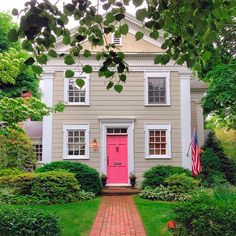 Bright pink door pops against the neutral exterior