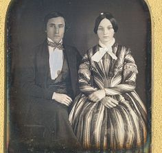 "Early ""square-cut"" quarter plate daguerreotype of an attractive young couple, anonymous American ca. 1845. Housed in a full leather case with repaired spine, some sprung corners, and exterior wear. With light hand-coloring in pink as well as hand-pricking to simulate the glitter of jewelry."