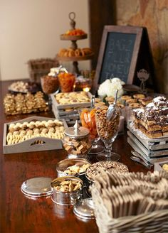 A rustic dessert station offers everything from nuts to fresh cookies. Wedding dessert favors.
