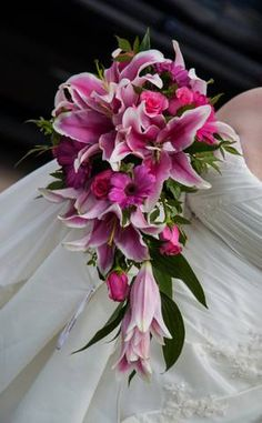 Bridal bouquet. Stargazer Lillie's, pink roses and pink gerber daisies. http://thepolishedpetal.weebly.com/surreal-silks.html