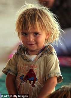 An Iraqi Yazidi girl on the outskirts of the Kurdish city of Dohuk. Yazidis are an ethno-religious group of Kurds, an Aryan or Iranic Indo-European race that originated in what is now Iran and gradually spread into what are now portions of Syria, Turkey, and Iraq. They absorbed some Semitic, Assyrian and Aramaic, Armenian, and, later, Turkic elements.