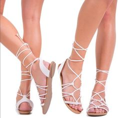 White Summer Sandals Super cute open toe strappy sandals for everyday wear. Has a fun lace up detailing with a tie knot finish. Pair them up with a cute floral dress or some hot summer shorts. Fits true to size, smooth insole for comfort & is made out of faux leather. Shoes Sandals
